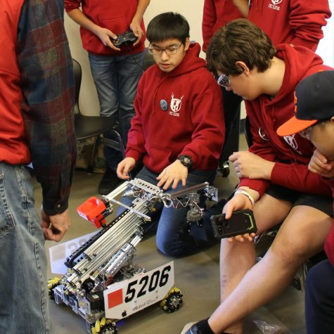 Andrew Chiang guides his robotics team.