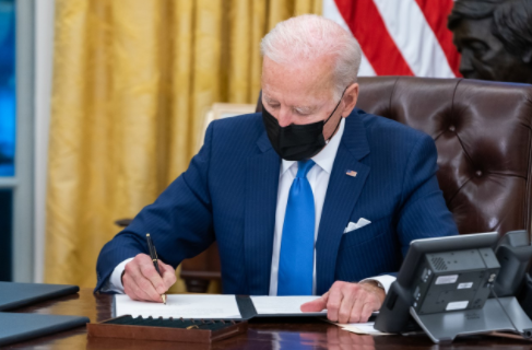 President Biden signing an executive order in the Oval Office. Wikimedia Commons